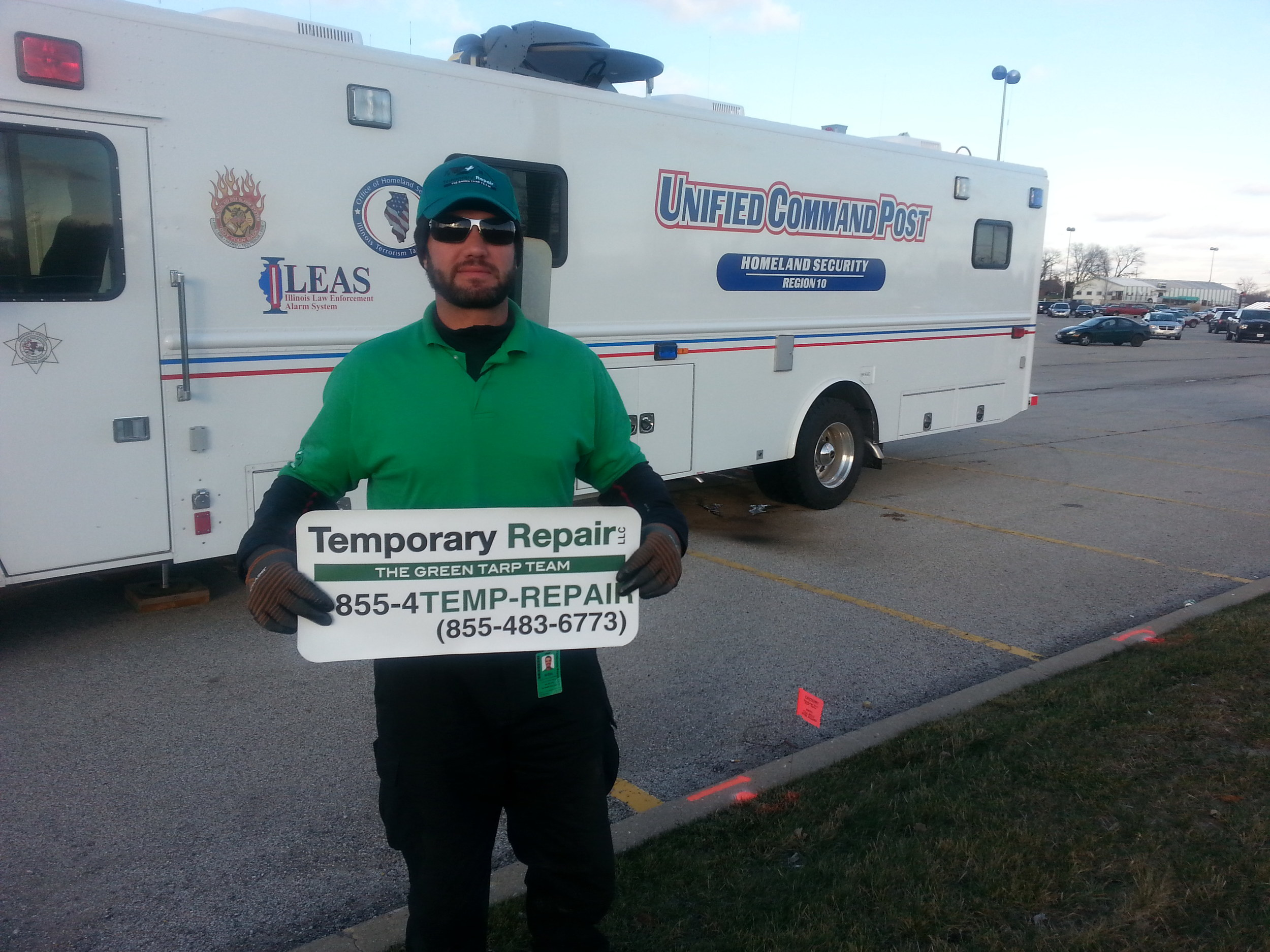 Temporary Repair Team Member in front of Homeland Security Van in Washington, IL