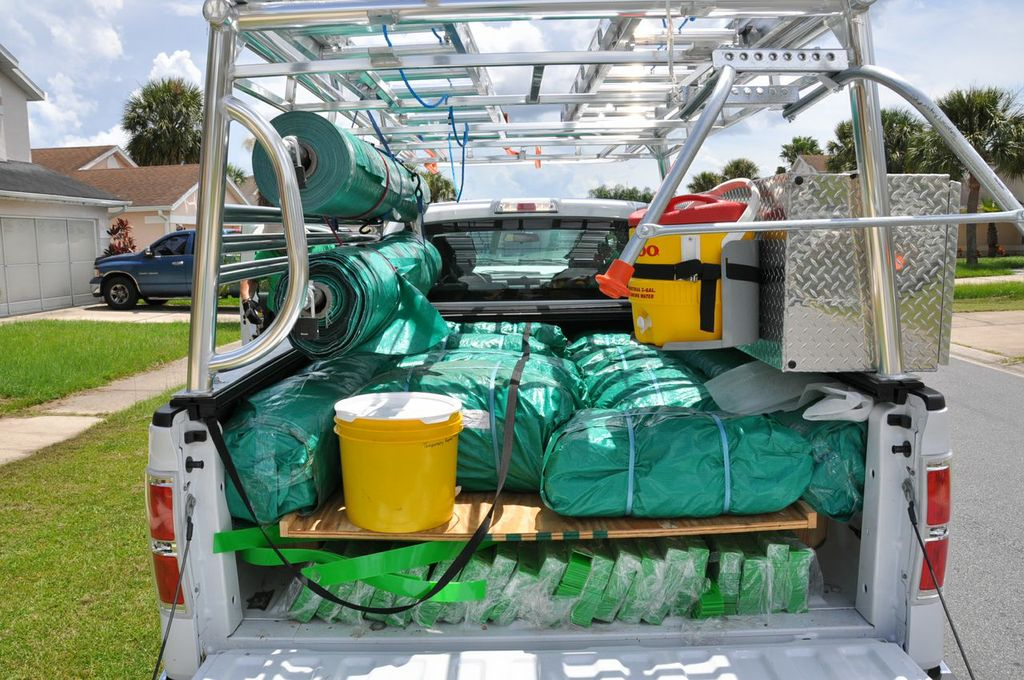 See our custom rolls of tarps on the left side of the truck that allows us only to covered what is damaged.