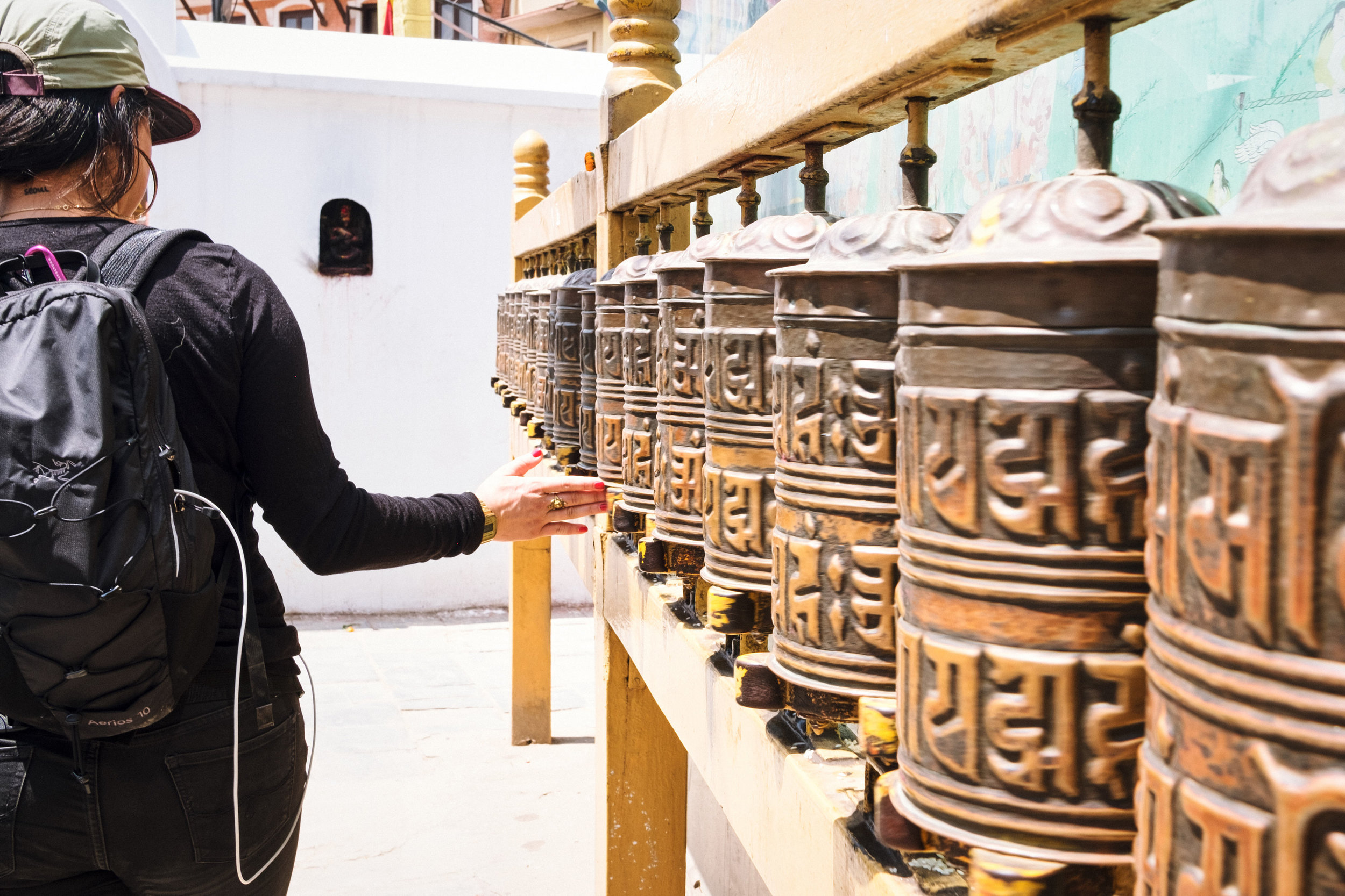 Always walk to the left  - of prayer wheels and stupas, a sign of respect in the Buddhist tradition. By walking clockwise around a stupa, it reminds us to keep Buddha's teaching in the center of our lives.
