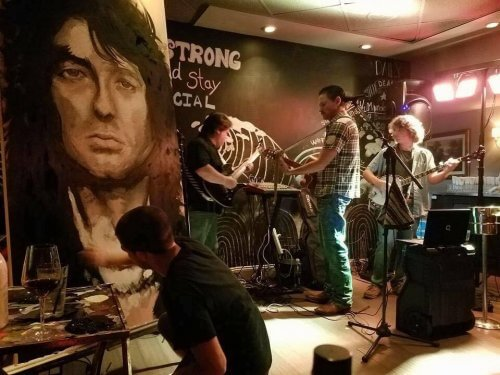 Marcus Zotter painting Jimmy Paige live at the 7th Avenue Social