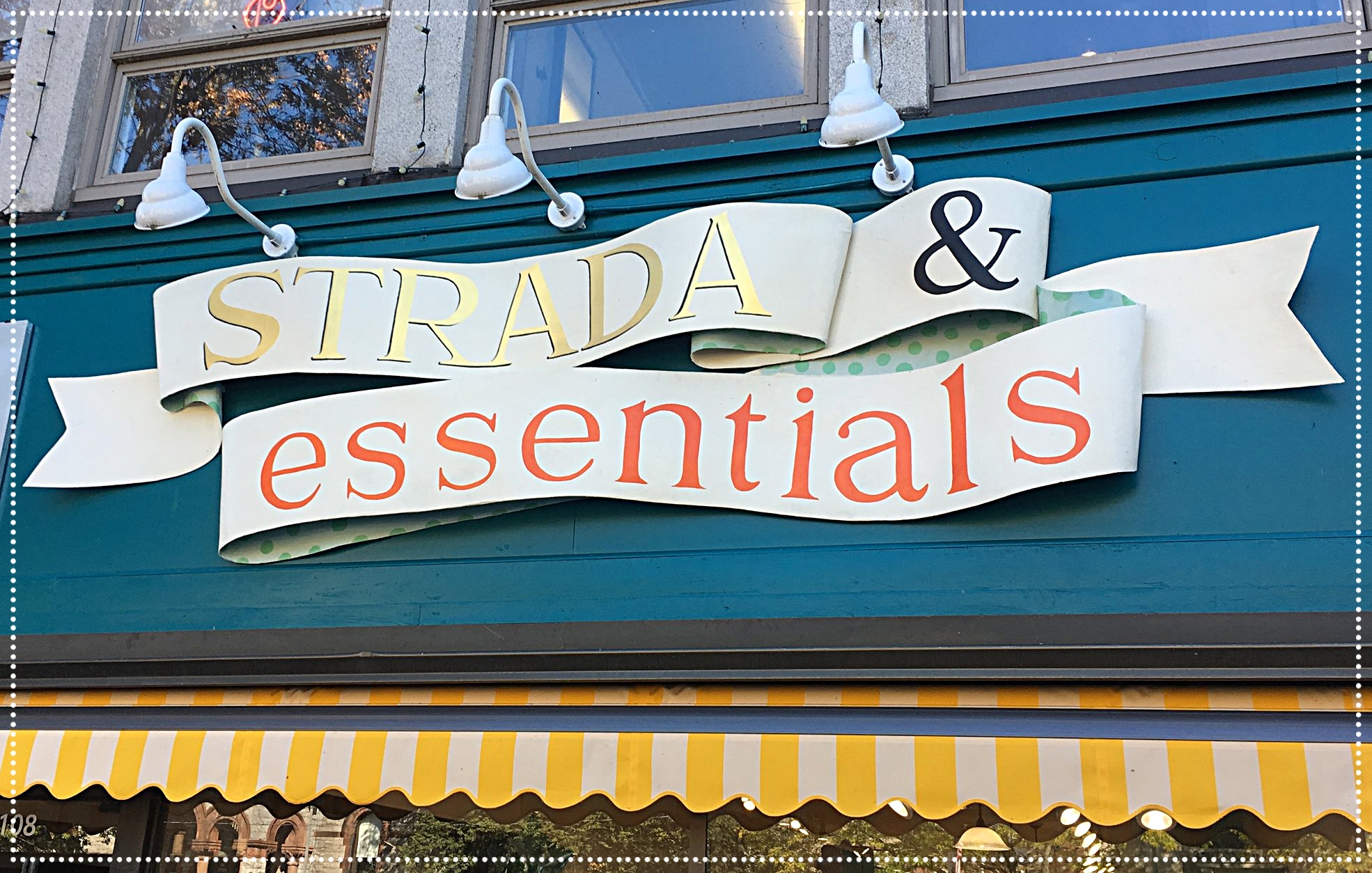 Our new sign at our new location, 108 Main Street, shared with Strada Shoes as of September 2017!