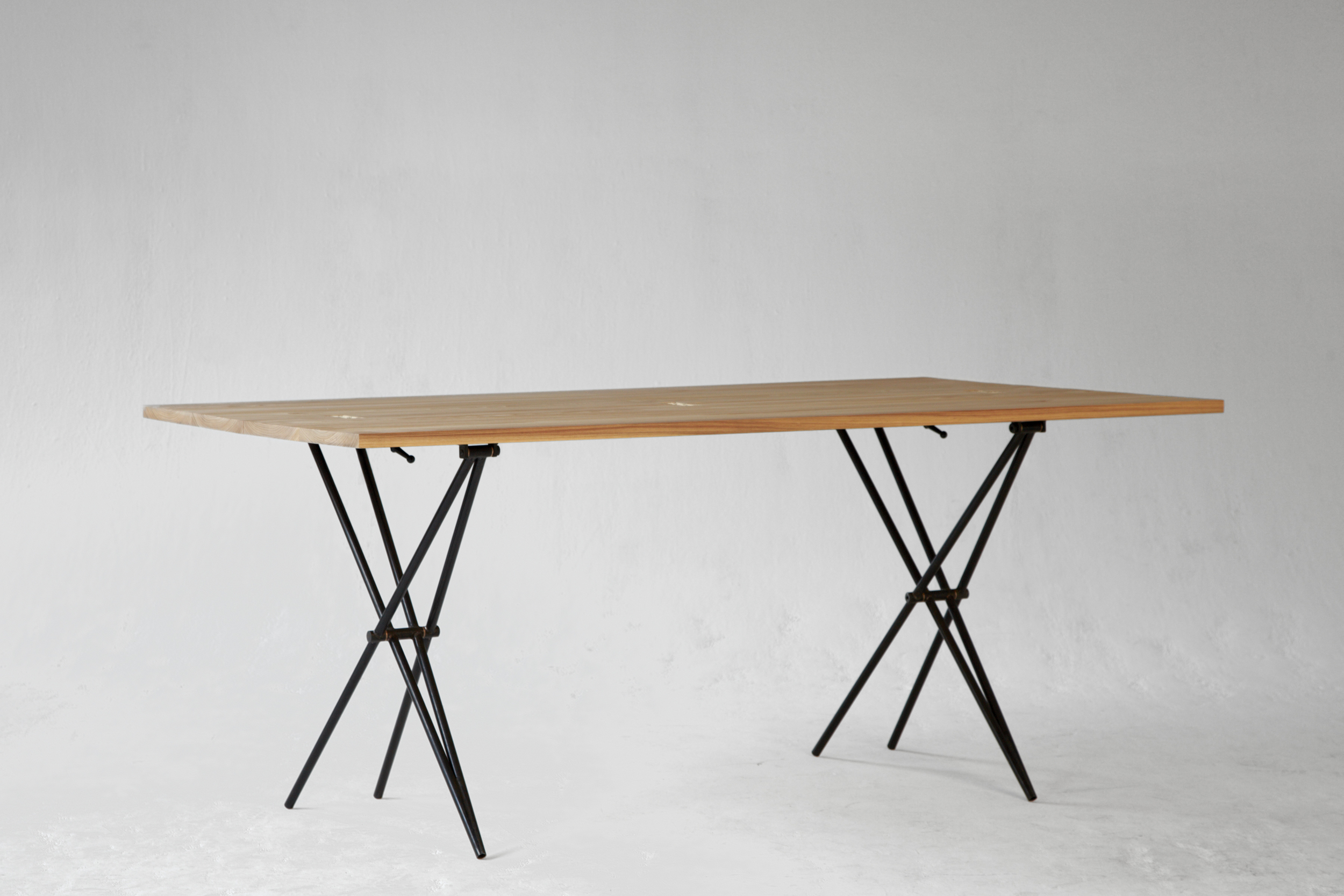"Configured as a 72"" by 40"" dining table, the Larmer table can seat 6 comfortably, 8 intimately."