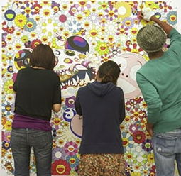 Assistants to Takashi Murakami working on one of his paintings in his New York studio