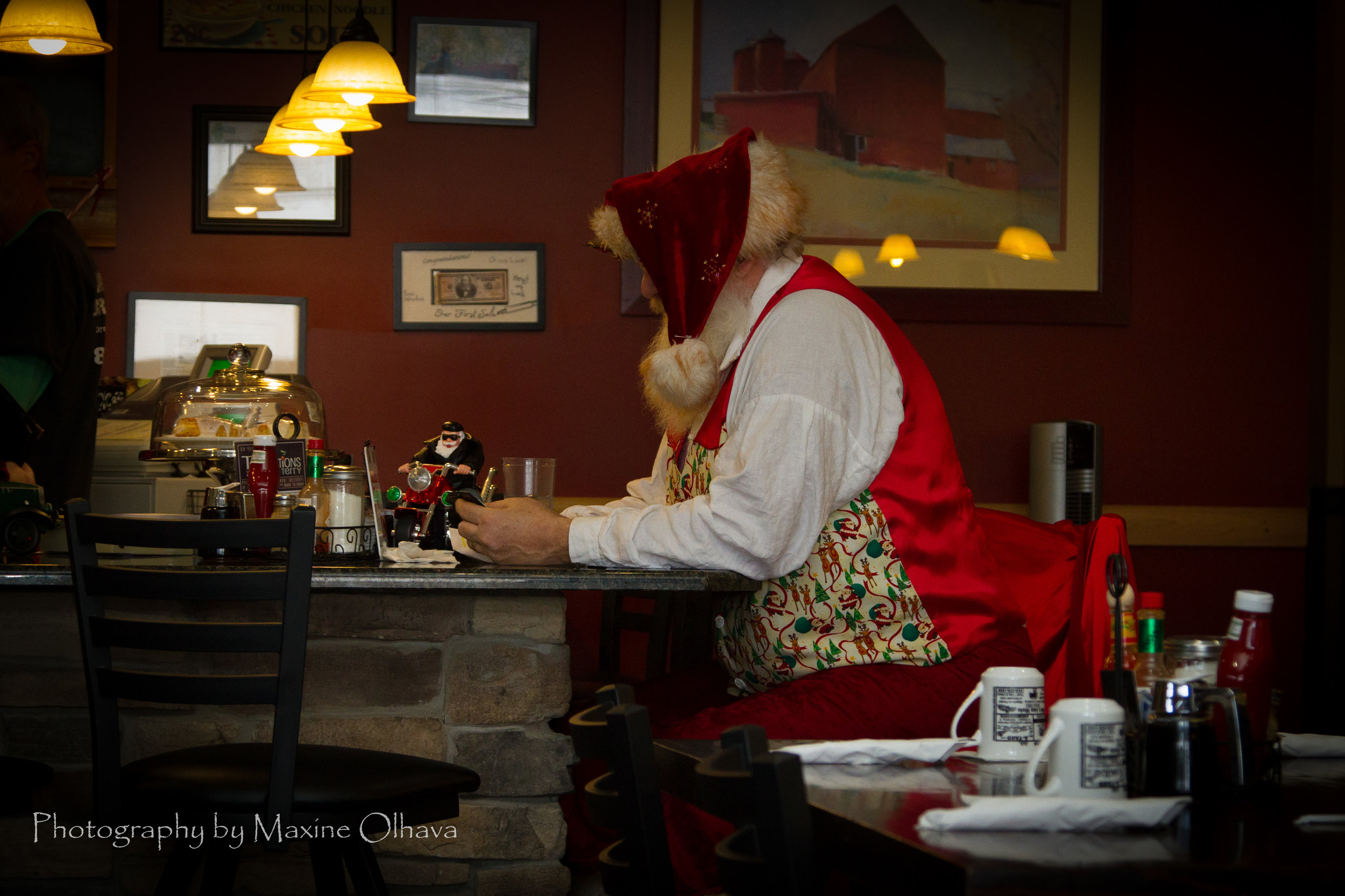 Santa checking in with his elves to let them know the kids were on the NICE list!