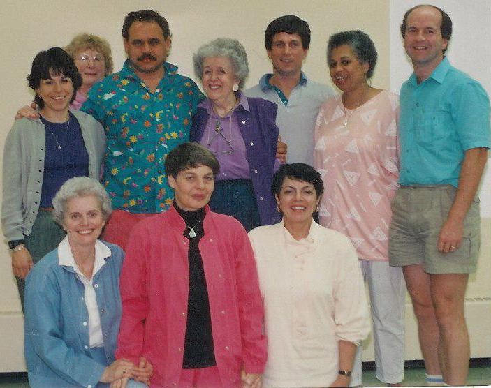 Lynne Azpeitia & Virginia Satir with the Satir Global Network Board of Directors. At Geneva Park in Ontario, Canada 3 months before Virginia died and 1 month before she discovered she became ill. Lynne is top left, Virginia is behind her with her hand on Lynne's shoulder. Lynne Azpeitia was Treasurer and on the Executive Triad at the time and after Virginia died.