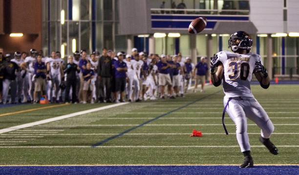 Laurier running back yrel Wilson misses a pass in the end zone during the 2012 season opener with Toronto as the entire team looks on.