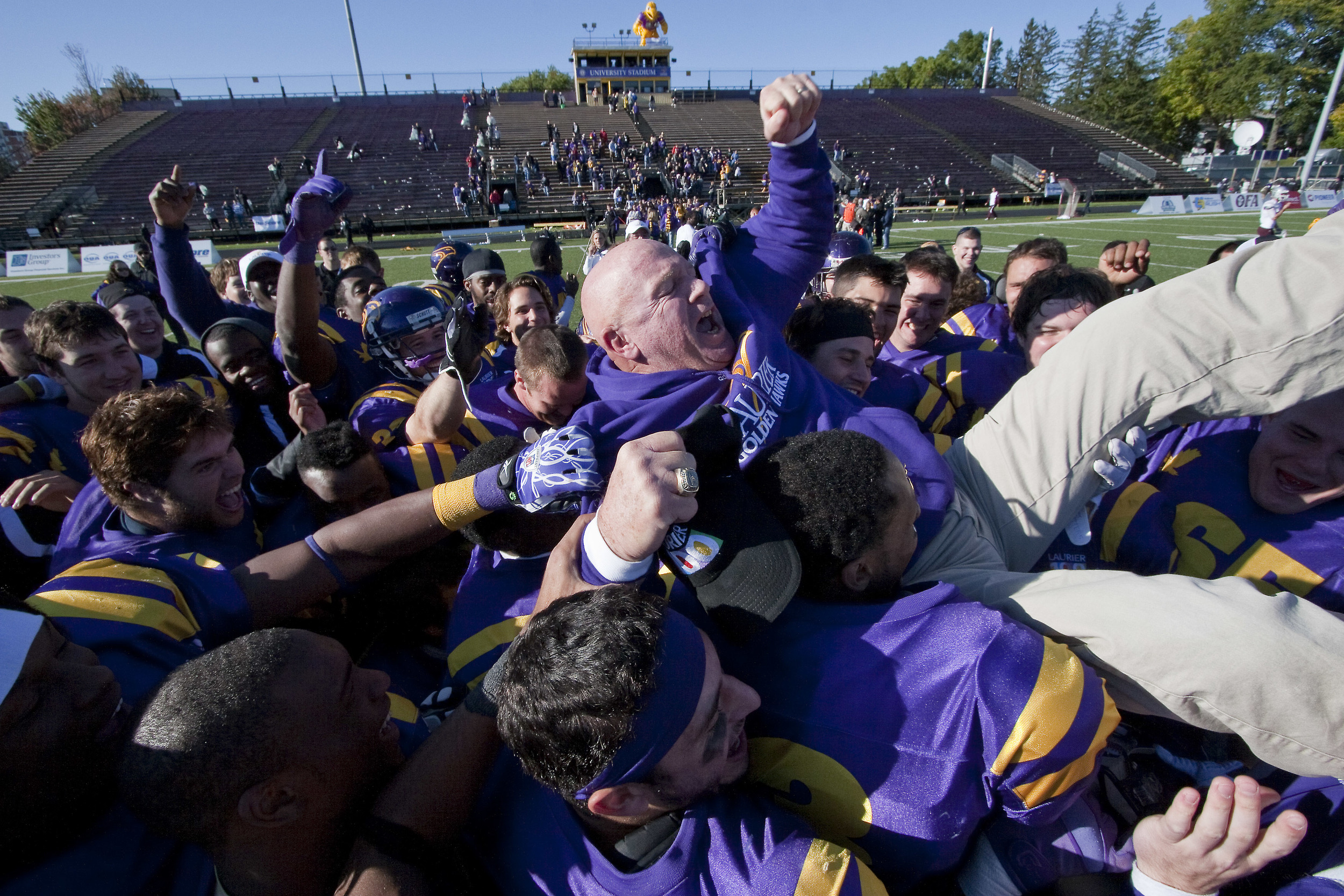Wilfrid Laurier University football coach Garry Jefferies is hoisted into the air after a homecoming win, October 1, 2011.