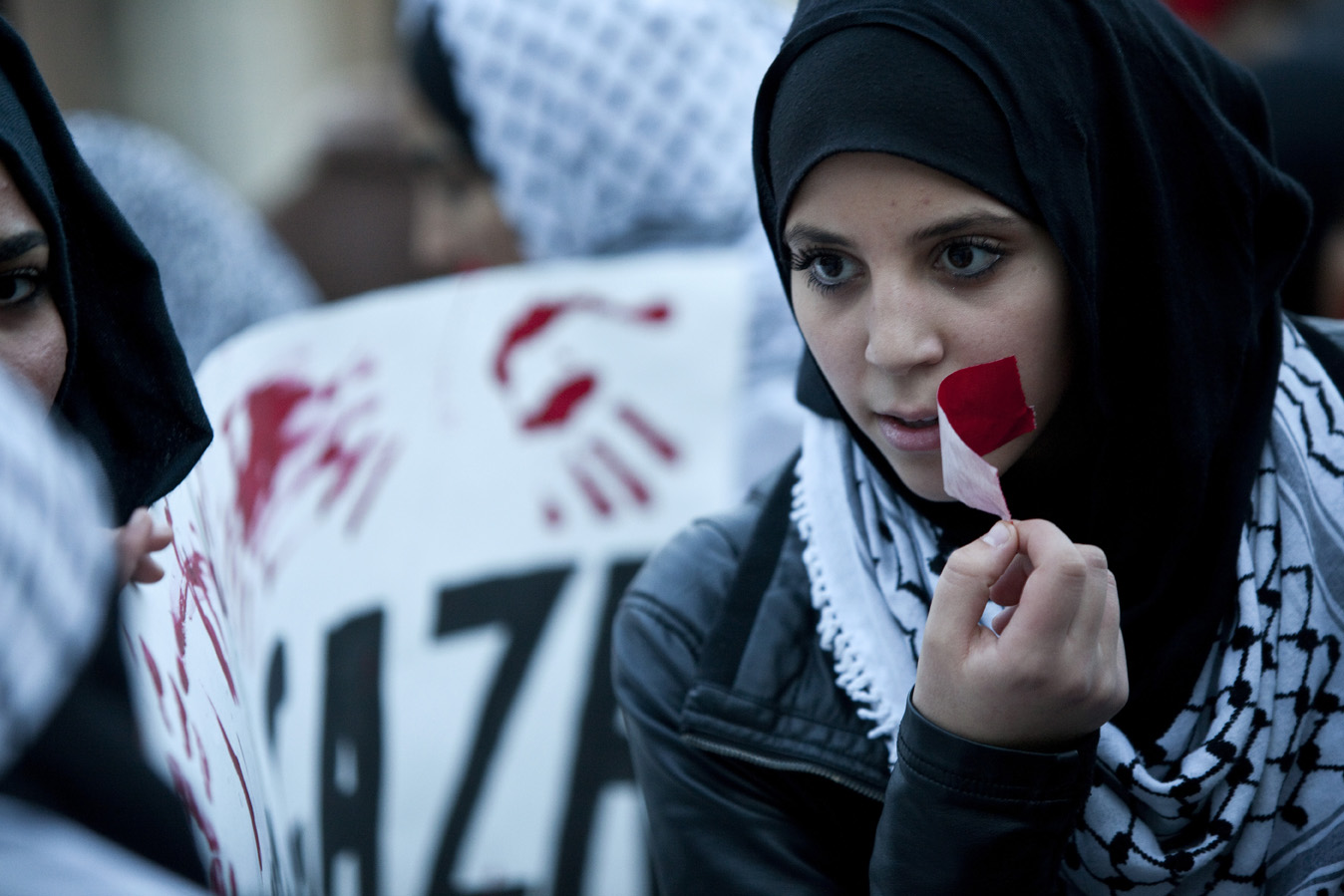 Palestinian protestors peacefully demonstrate in solidarity with Gaza.