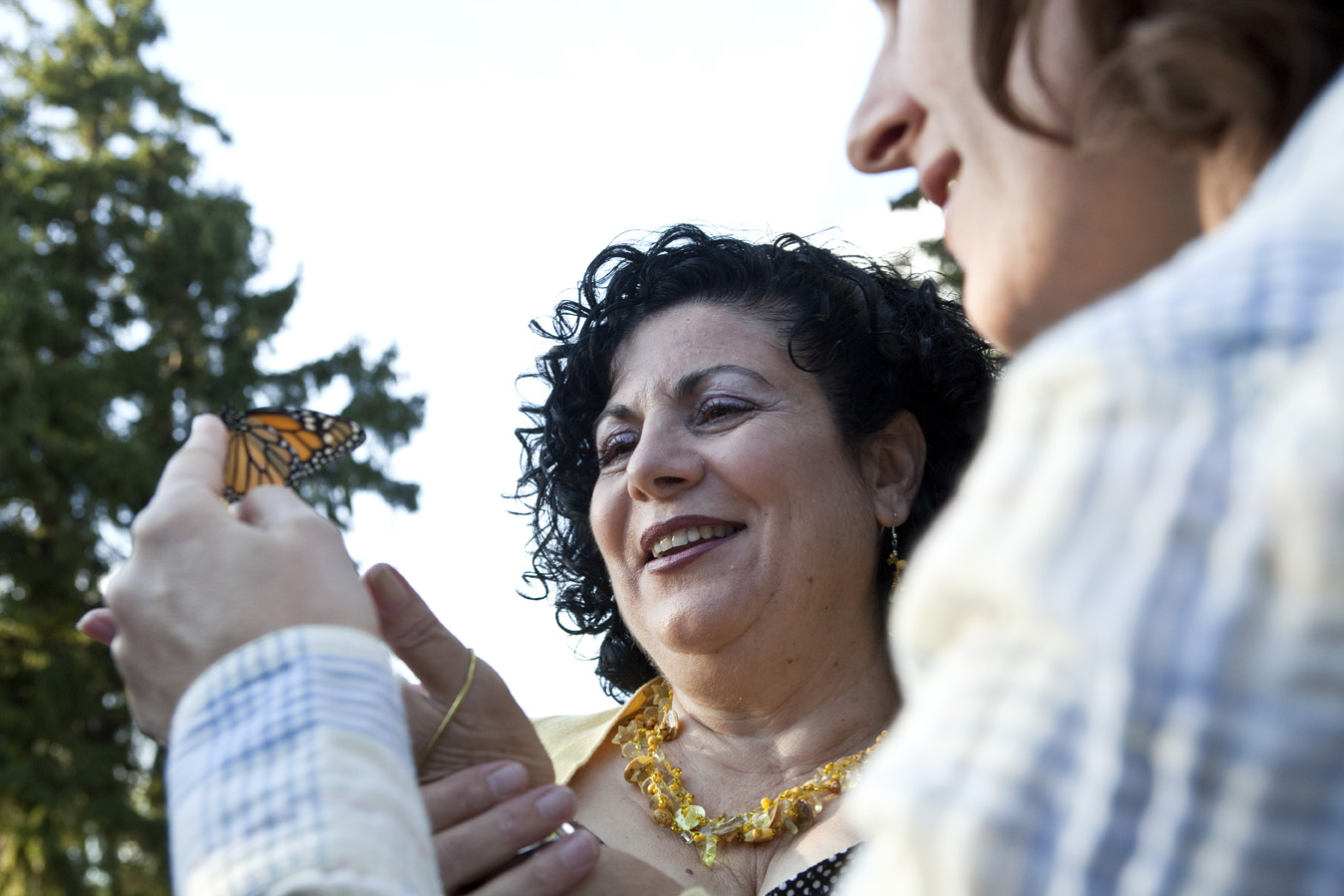 Maria Macrae releases a butterfly as part of a suicide awareness event.