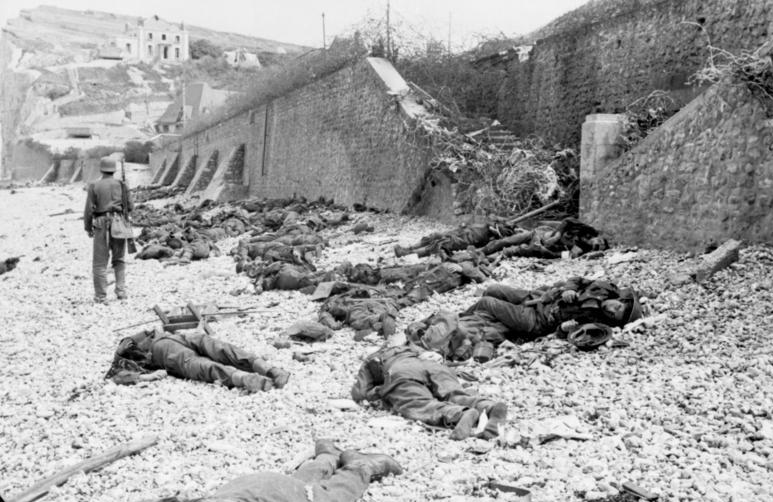 Dead of the Royal Canadian Regiment litter the beach at Puys, France atter the August 19, 1942 raid on Dieppe.