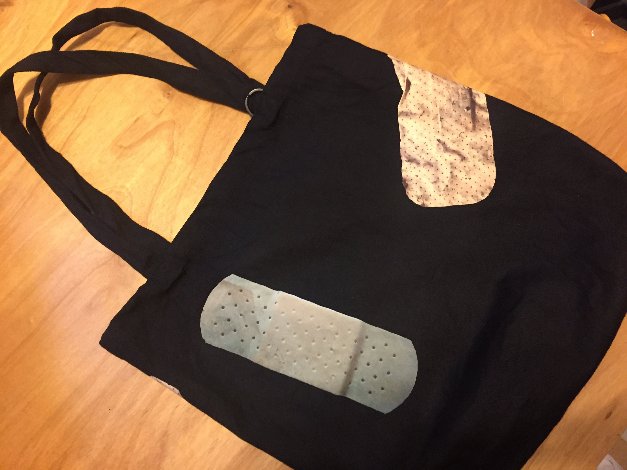 "Bandage Tote, 15""x15""x4""  Heavy 10oz 100% cotton. Pre-washed and Shrunk. 24"" handles. Available in Black and Natural. Comes with a ring for key chain. Each Bandage Bag is unique."