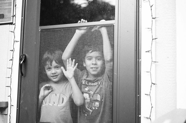 When the world is large and your face is the same height as door handles.  Grandma's backyard in the summertime. . . . . #family #backyard #summertime #cousins #portrait #raw #real #beauty #personalwork #leica #bnw #photography #tones #kodak