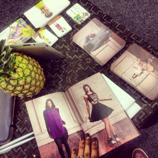 Lookbooks, postcards, and a pineapple centerpiece at our booth.