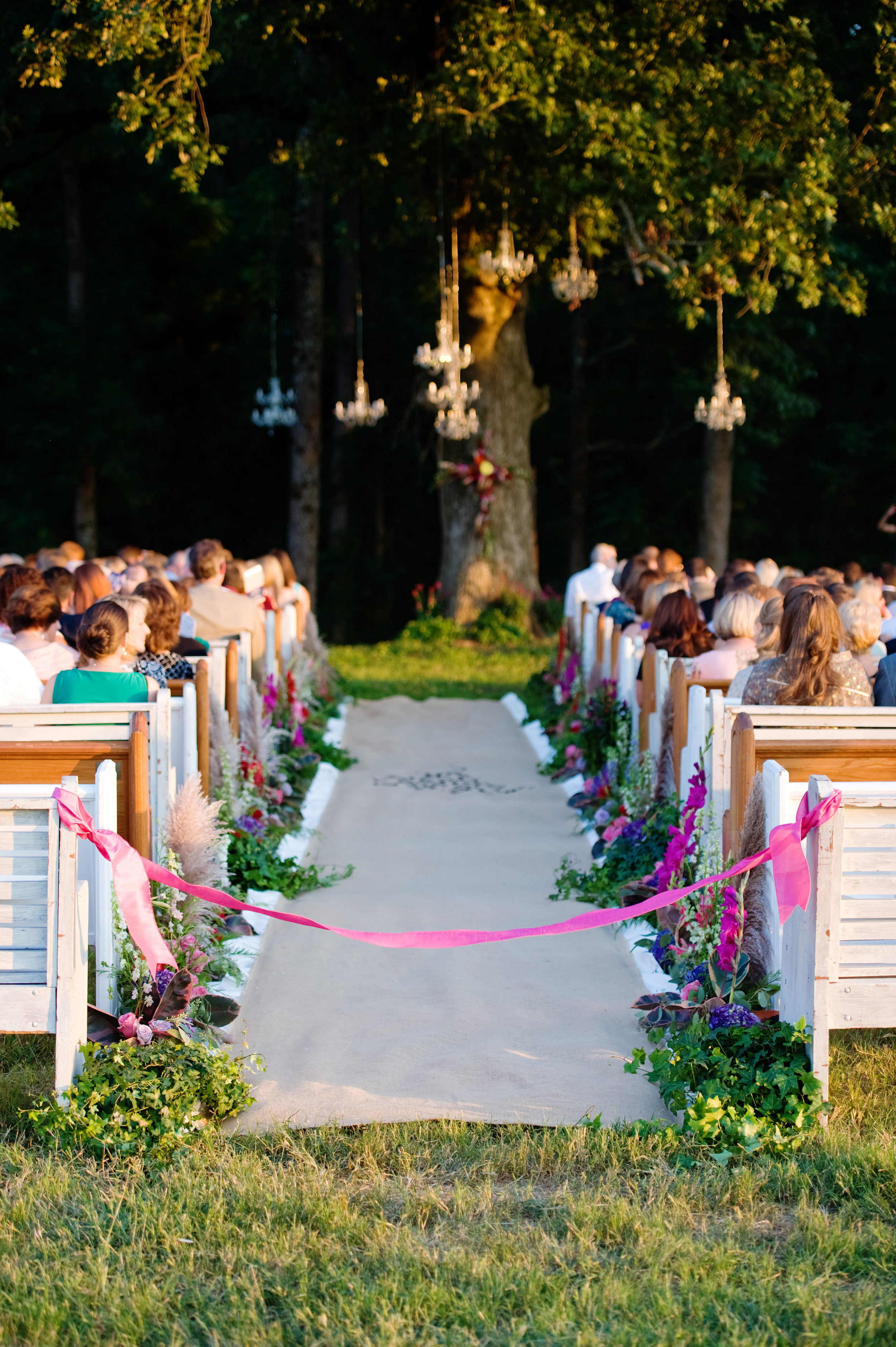 Mixed Church Pews at a Southern Wedding. Photos by Simple Color Photography, Flowers by HotHouse Design Studio, and Planning by Meghan Cease.
