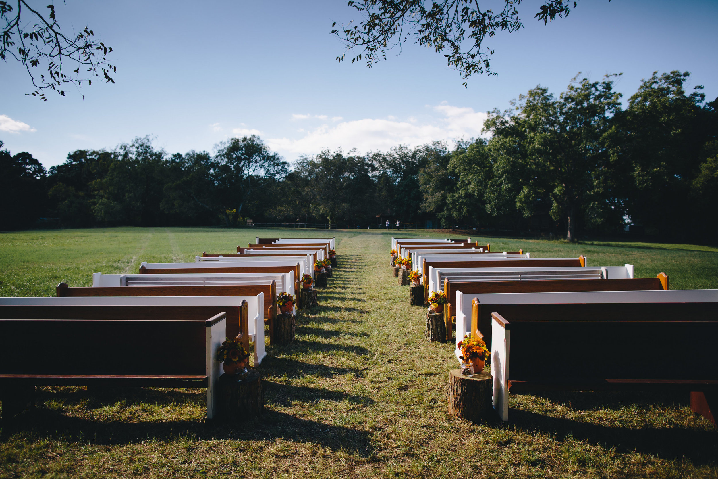 Photographed by: Anne Almasy www.annealmasy.com Outdoor wedding with pews. www.rentpews.com