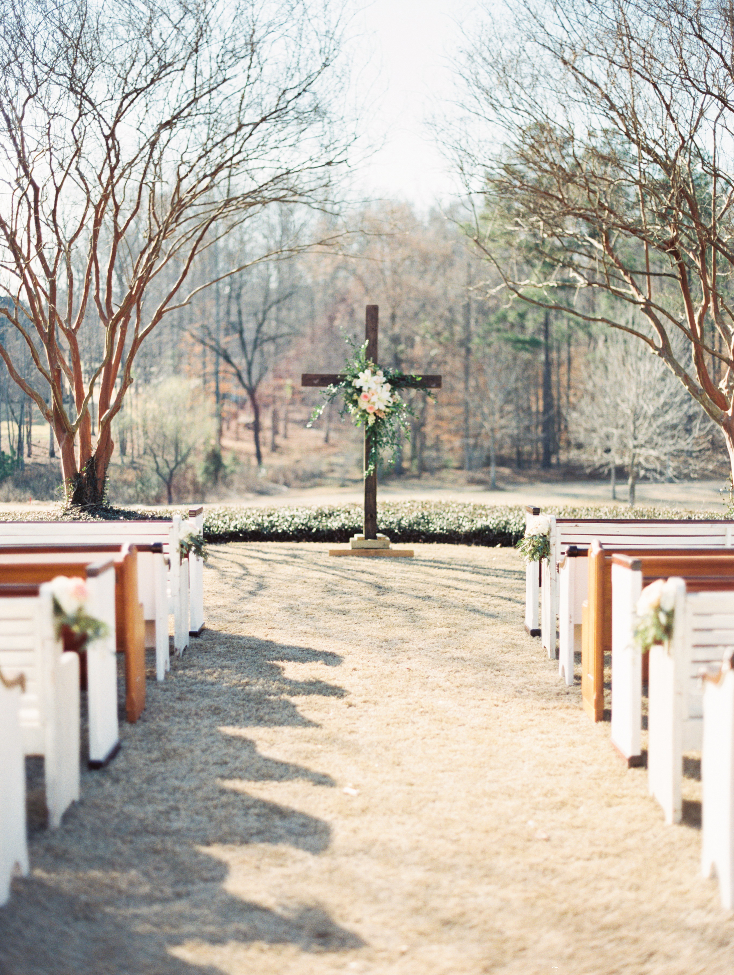 Pews at a Southern Wedding. Photo by Taylor Lord Photography