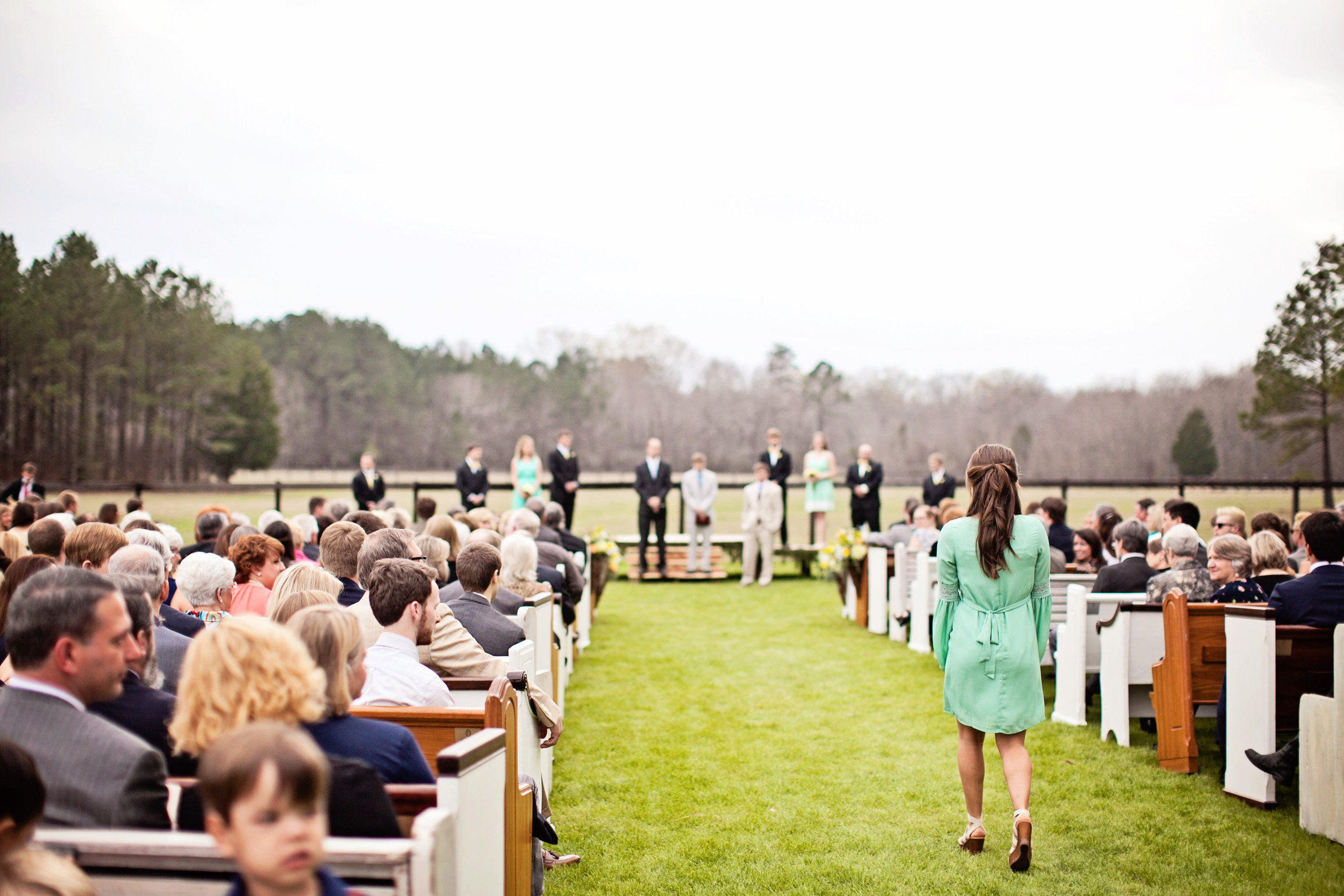 Alabama outdoor wedding with church pews. P.E.W.S. www.rentpews.com  Photography: Cameron Freshwater www.cwfphotography.org