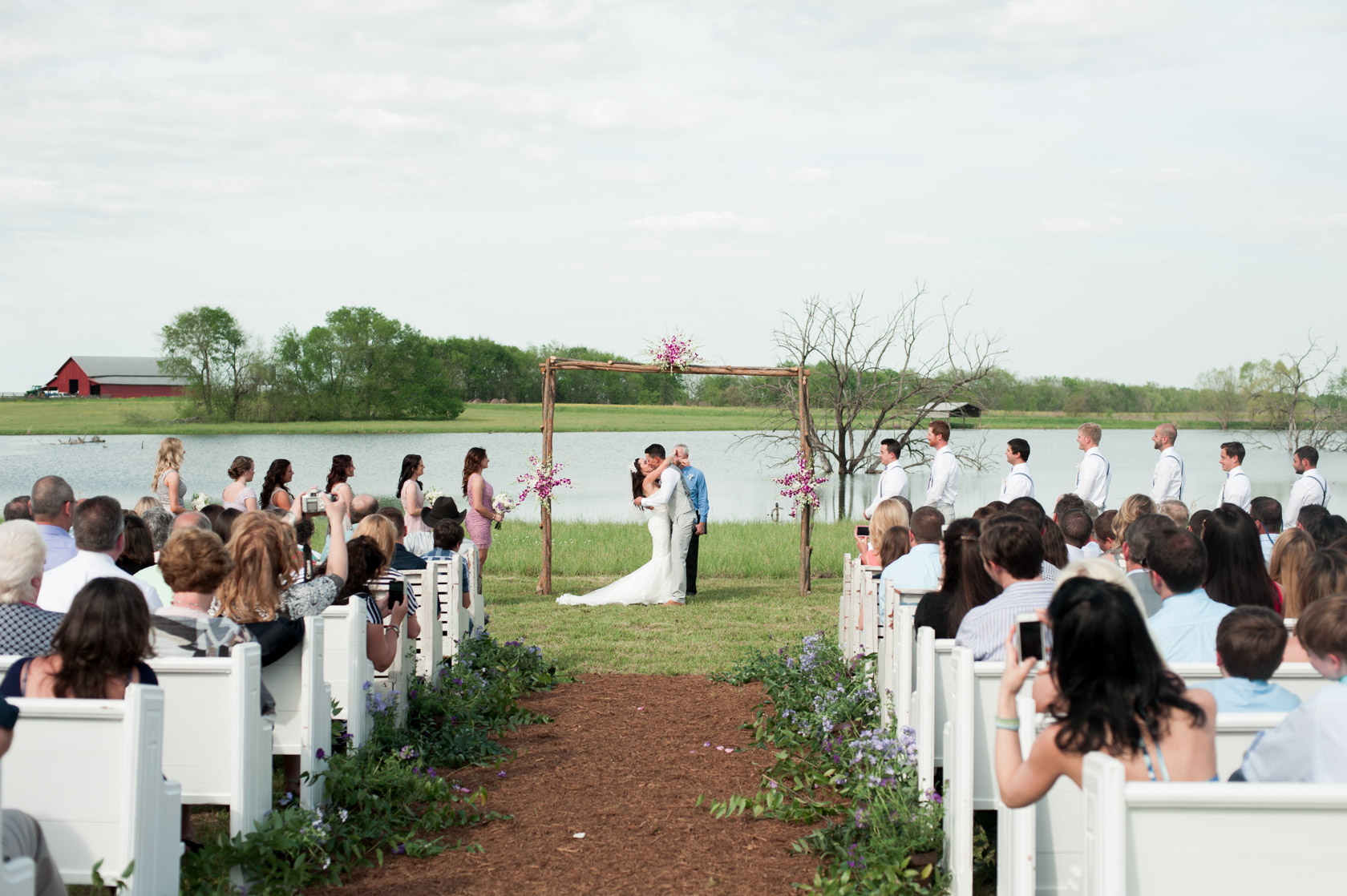 Church pews at an outdoor, Alabama Wedding. Photos by Kelli + Daniel Taylor Photography