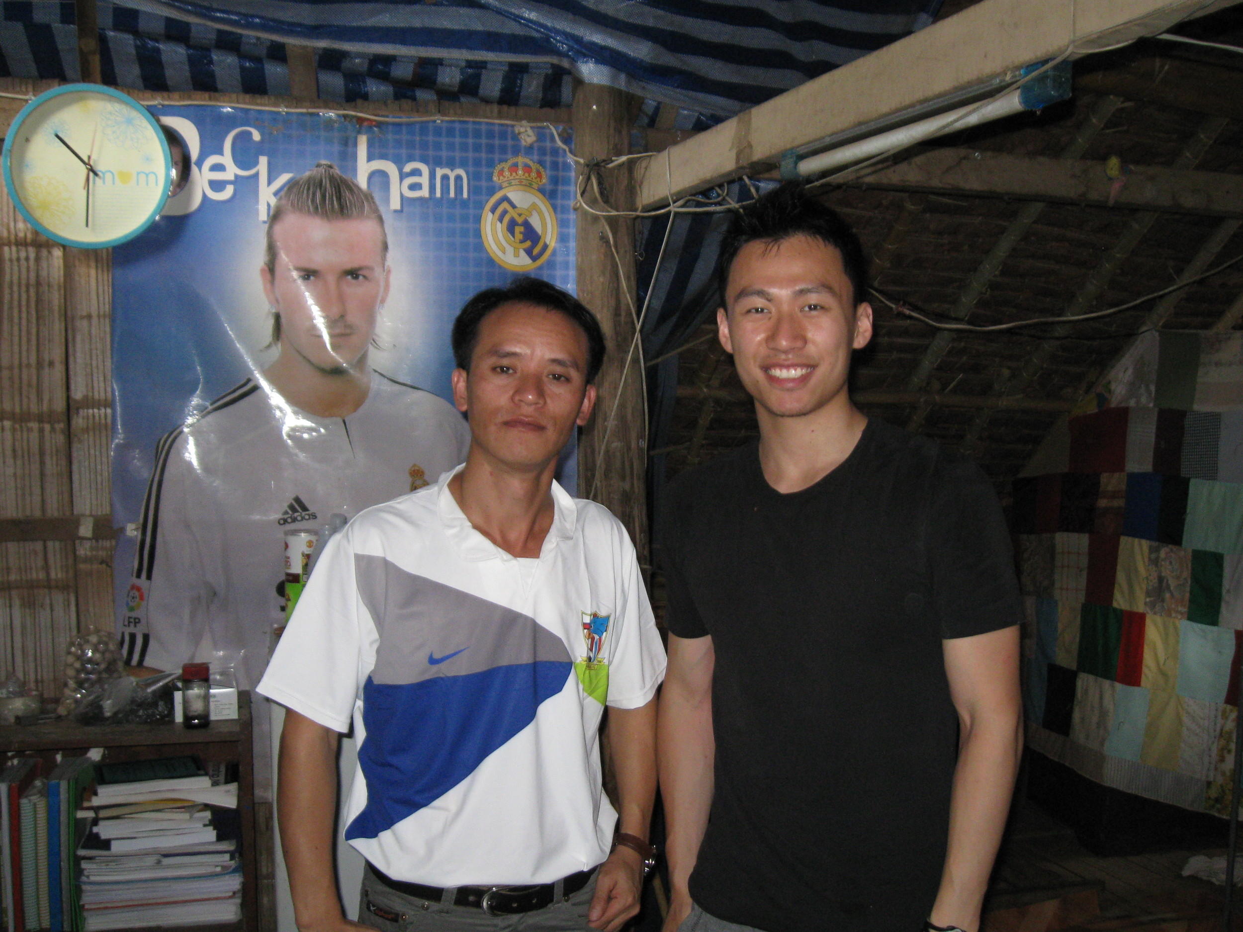Sew Alwyn and I posing in front of his Beckham poster. He is an avid soccer fan.