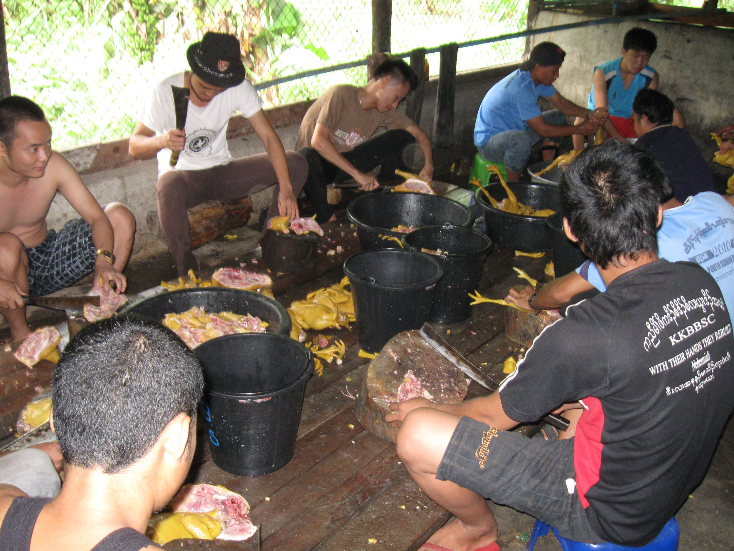 On Day 2, church ministers from other Karen refugee camps arrived for an annual conference. The men are preparing the chicken. The women prepare the vegetables.
