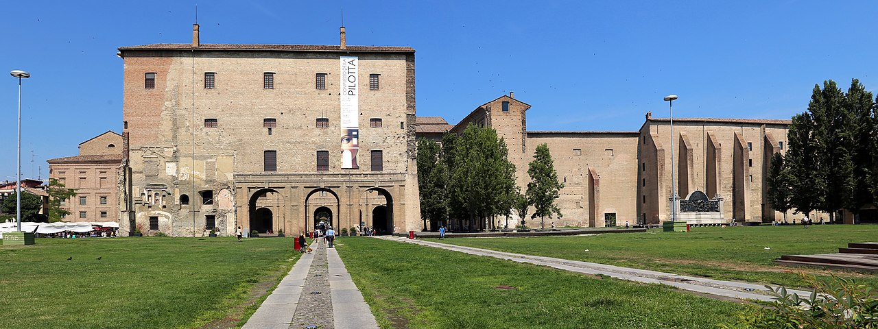 View of Palazzo della Pilotta. The rebuilt part on the right is where once was the church of St. Peter.  The large hole was caused by a bombing. CC BY-SA 4.0