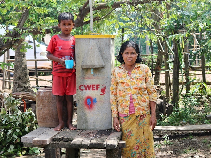 Cambodian mother and son with their new BioSand Water Filter