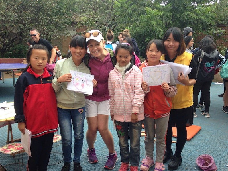 Concordia Shanghai teacher Dagne with students at community center