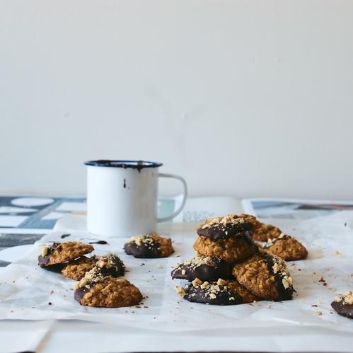 chocolate dipped oatmeal-hazelnut cookies