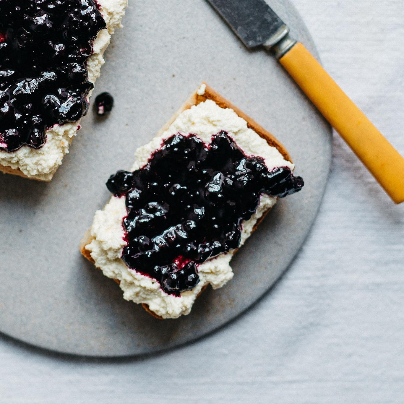 macadamia ricotta & black currant jam on toast