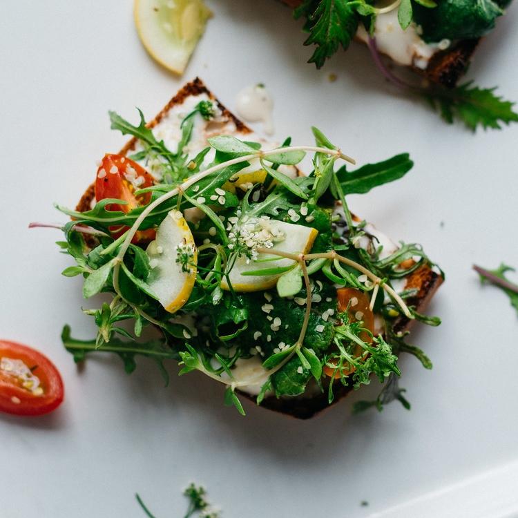 cilantro-hemo salad on tahini-yogurt toast