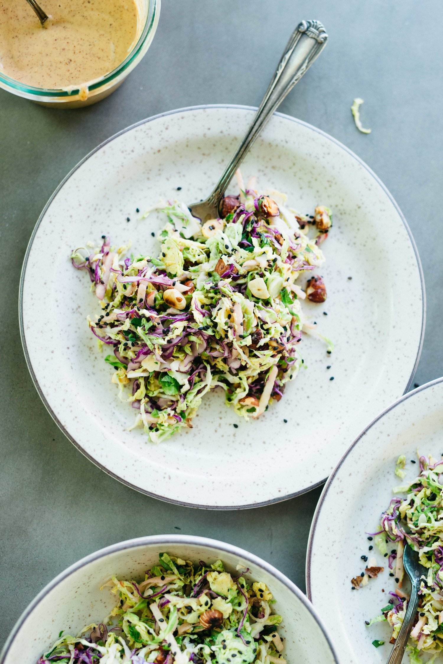 brussels sprouts, honeycrisp, & cabbage slaw w/ spicy almond butter sauce