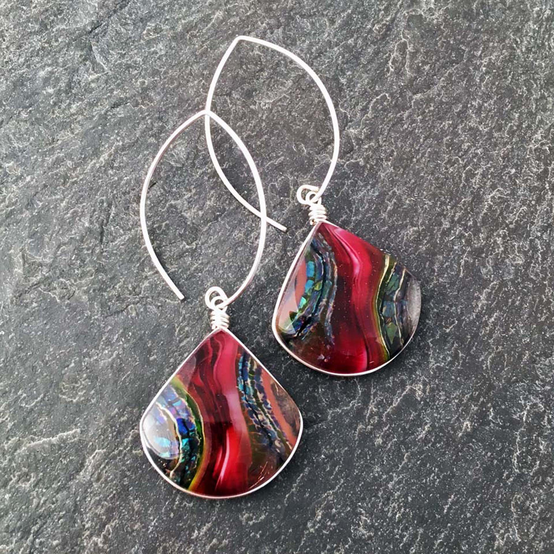 """4. Cranberry Stone Design Earrings, kiln formed art glass, 1"""" x 2.5"""" x .25"""", Earrings, Argentium sterling silver wire setting and ear wires, $67.00."""