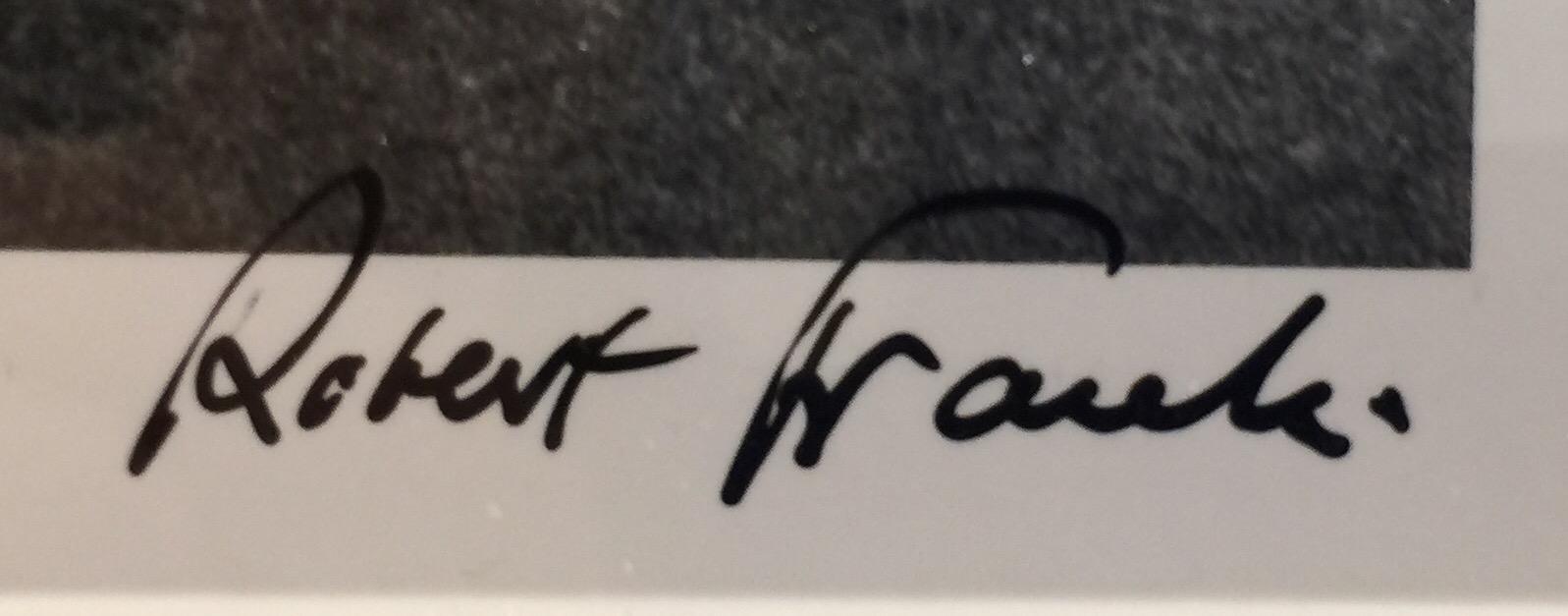 Firma di Robert Frank sulle foto