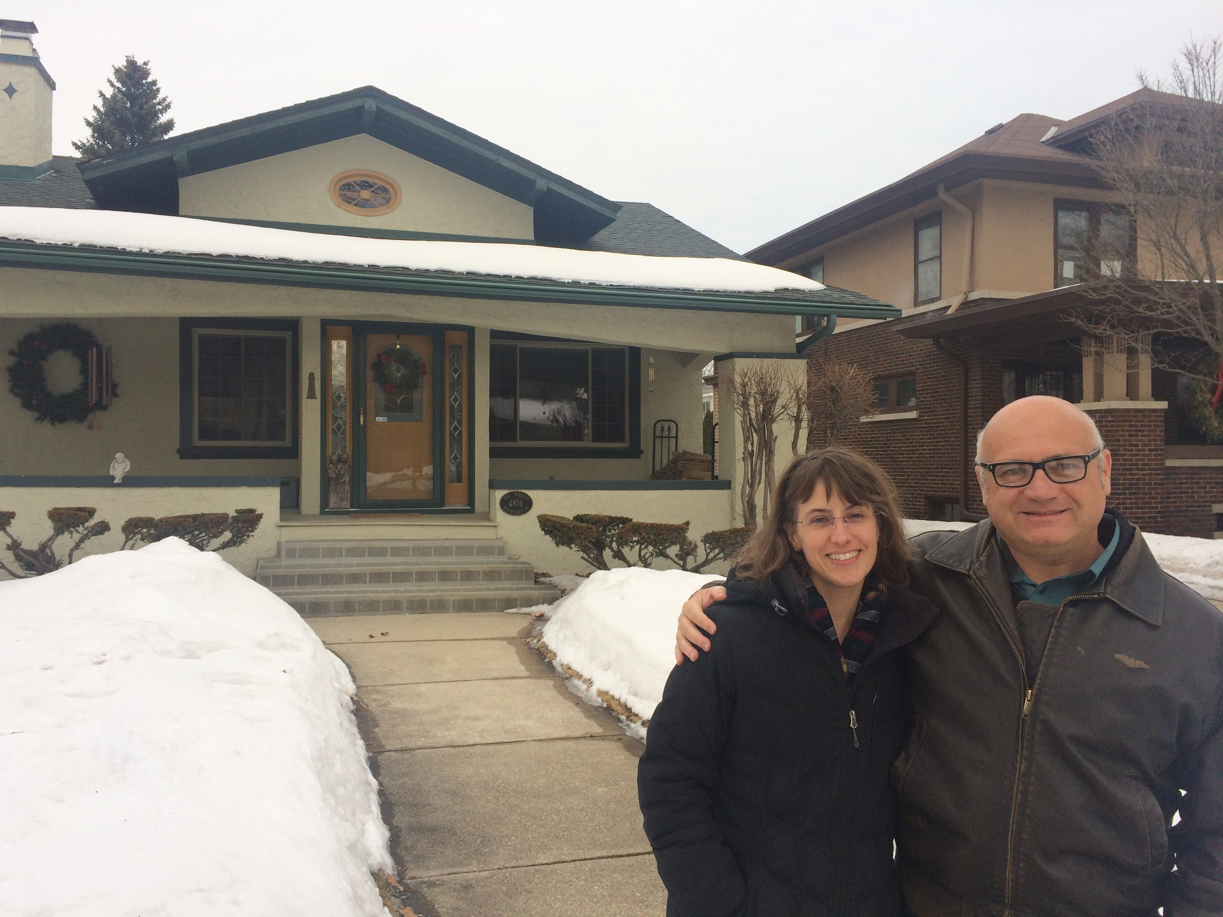 Cousins Merideth and Geordie in front of the ancestral home in Milwaukee.