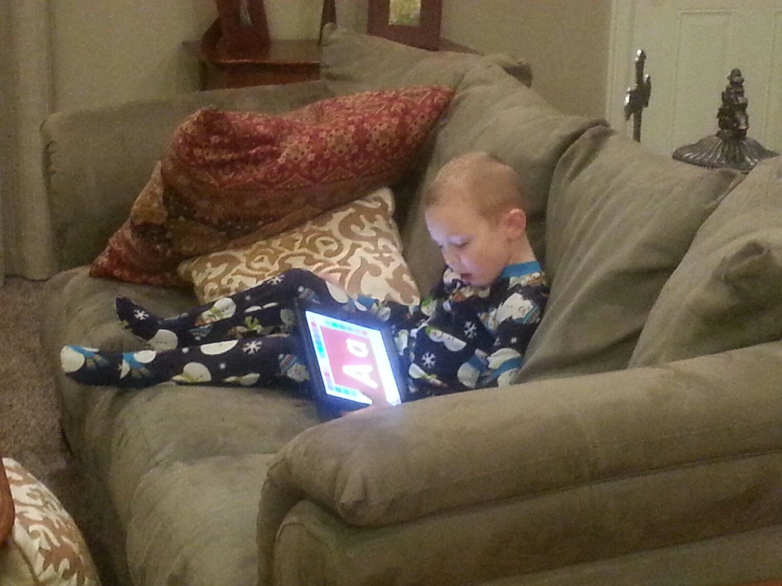Ezra loves to play on his I PAD...something that he was terrified to even touch this time last year! Little victories are never little!