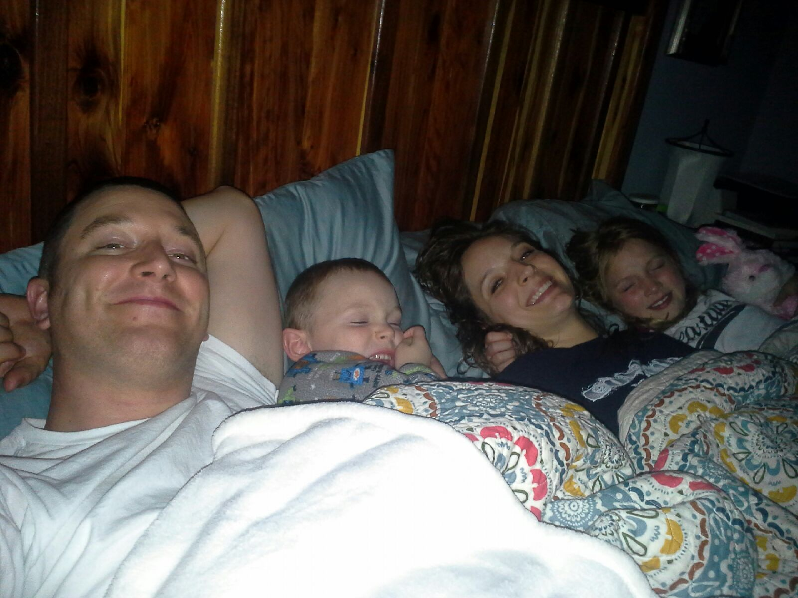 "Speaking of ""lying down"". guess who got into bed to snuggle with us for THE VERY FIRST TIME EVER!!!!? That's right! Ezra's new ""thing"" is to snuggle as a family in mom and dad's room! ...I can get used to that!"