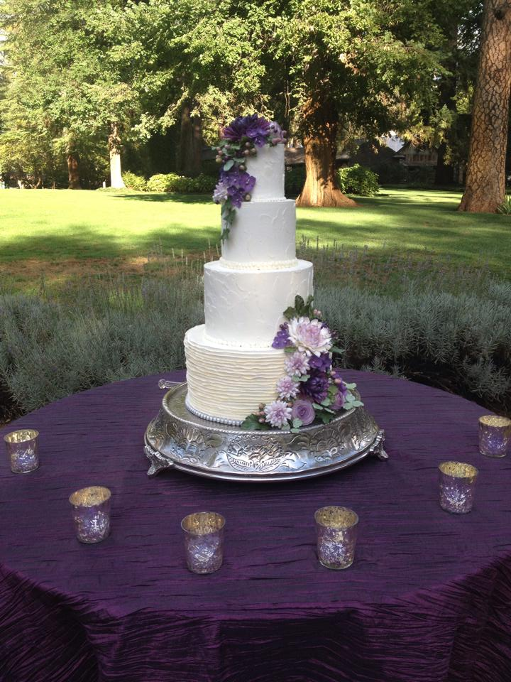 """Buttercream ruffles and purple sugar flowers"""