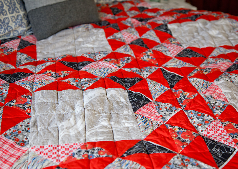 Crimson Waves  (detail), machine pieced and quilted. 2012