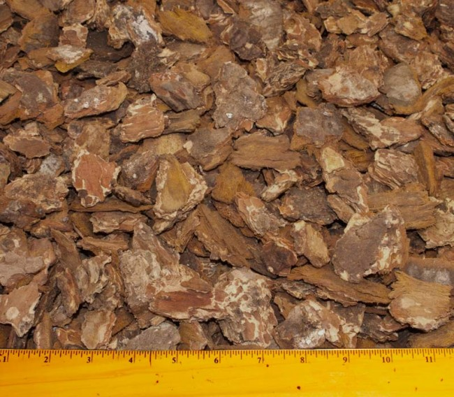 "Fir Bark Chips in  Small, Medium, and Large  (Medium ¾"" – 1 ½"" are shown) are great solutions for all kinds of unique landscaping situations.  $6.99/2 cf    Medium Fir Bark $3.99/2 cu ft Fir Bark Red Fines $3.99/2 cf"