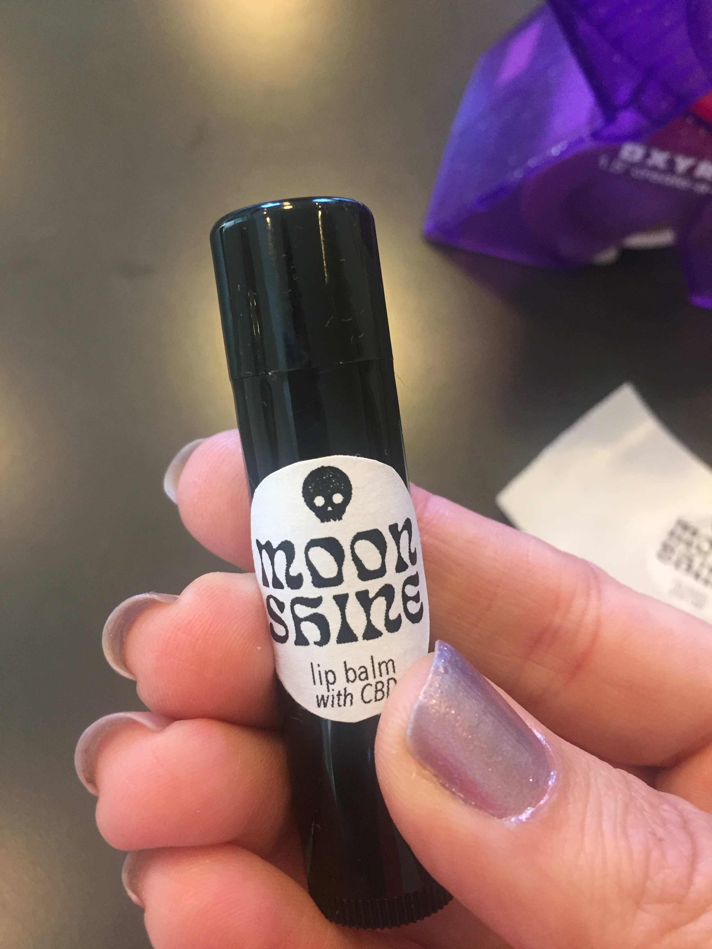 I made a batch of lip balm to give out at a cocktail party I'm hosting! The event is in West Virgnia.....hence, Moonshine. :)