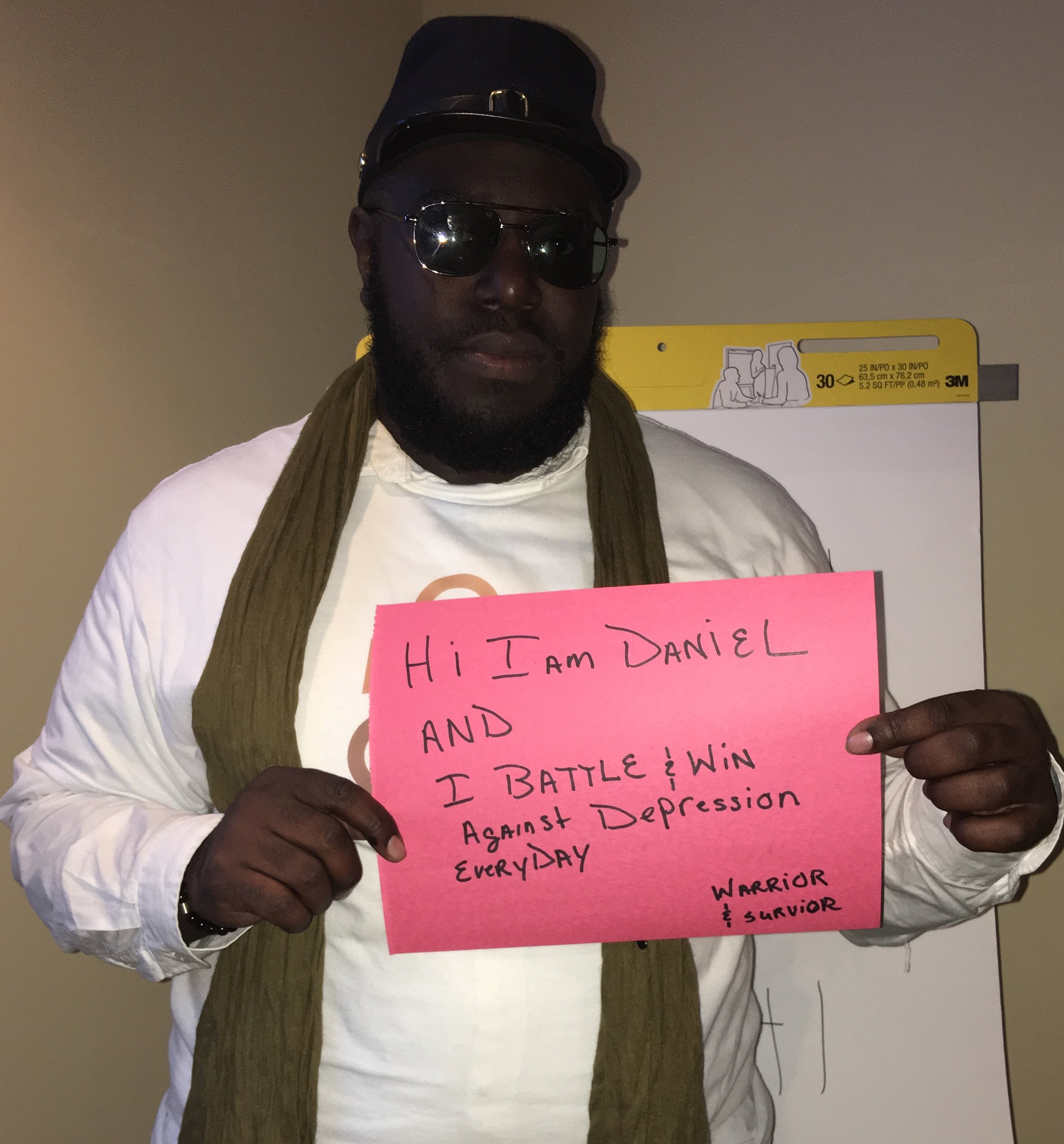 Sign: Hi I am Daniel and I battle and win against depression everyday. Warrior & Survivor