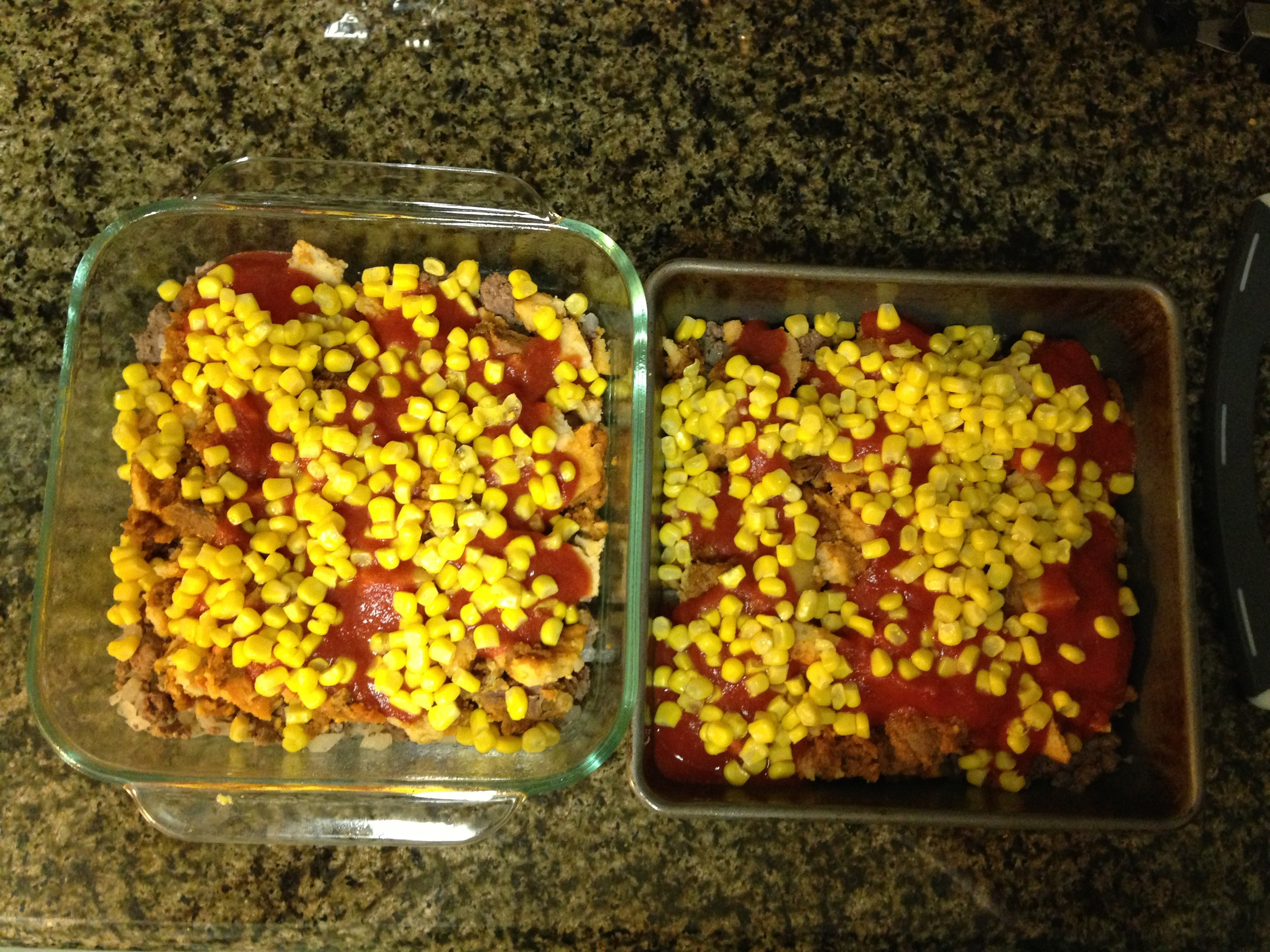 Over the tamales went some of the tomato sauce and corn kernels.