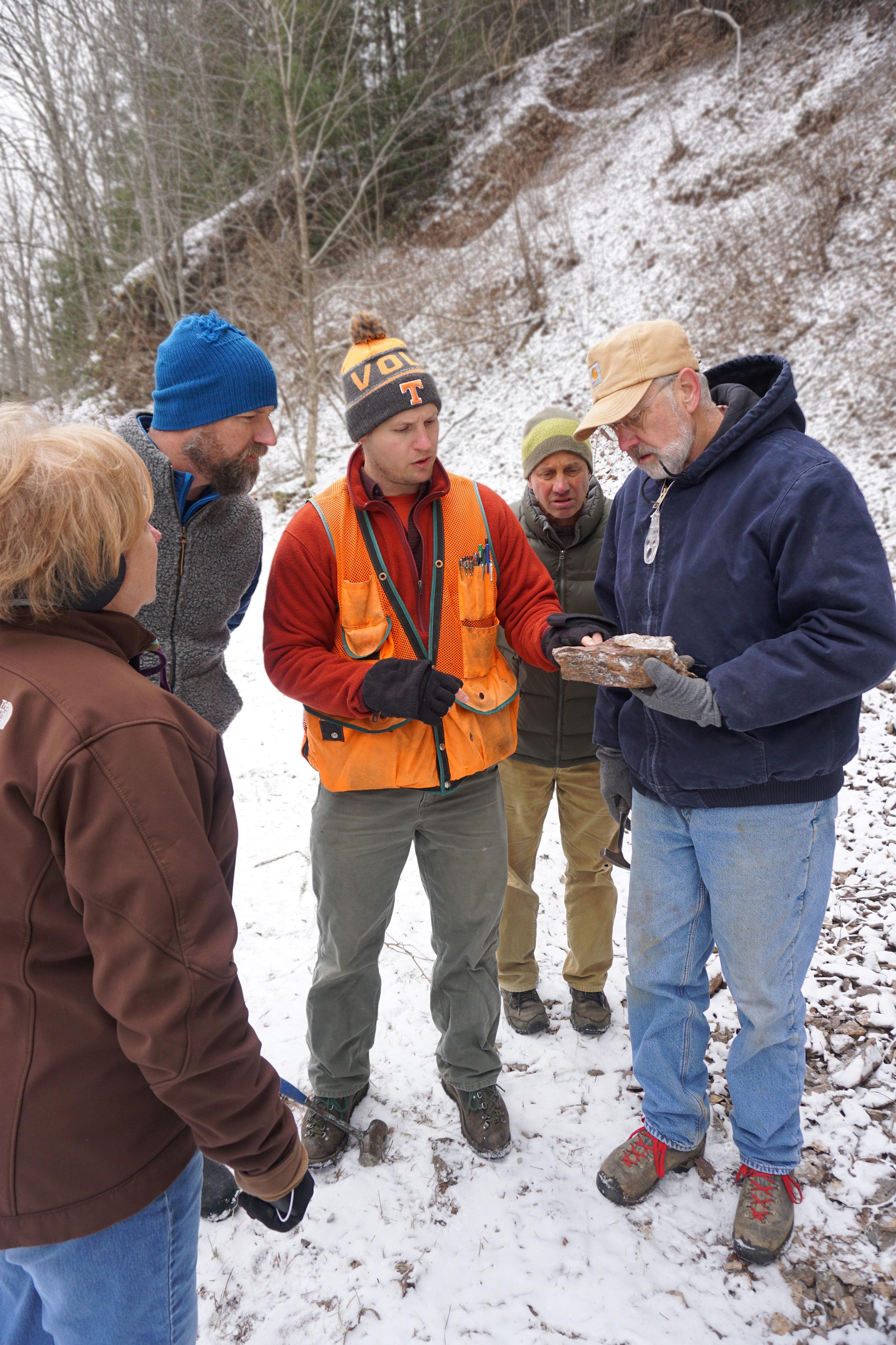 The crew discussing glacial dropstones.
