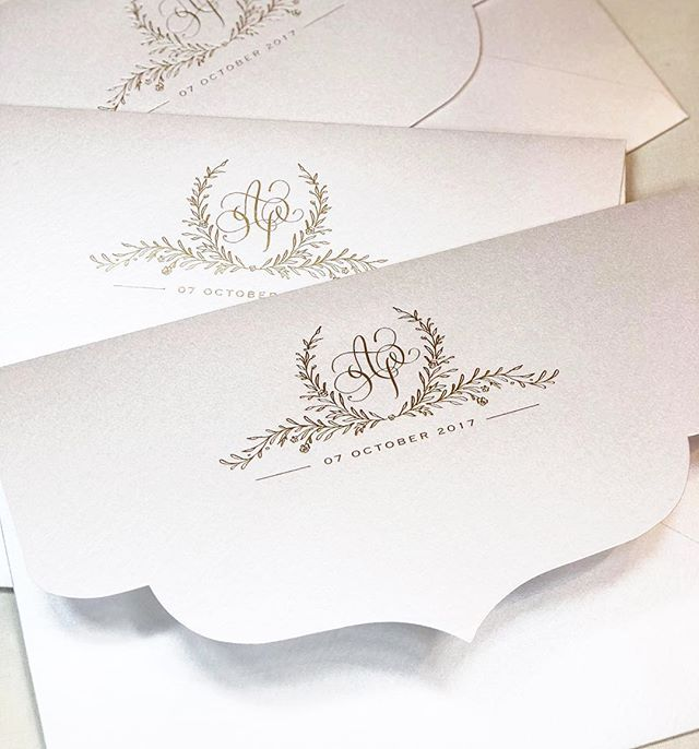 """I always love to hear """"wow"""" as soon as guests see the envelope! Having a custom pearlized die shape envelope with gold foil detailing is sure to get that reaction! #karaanne_paper"""