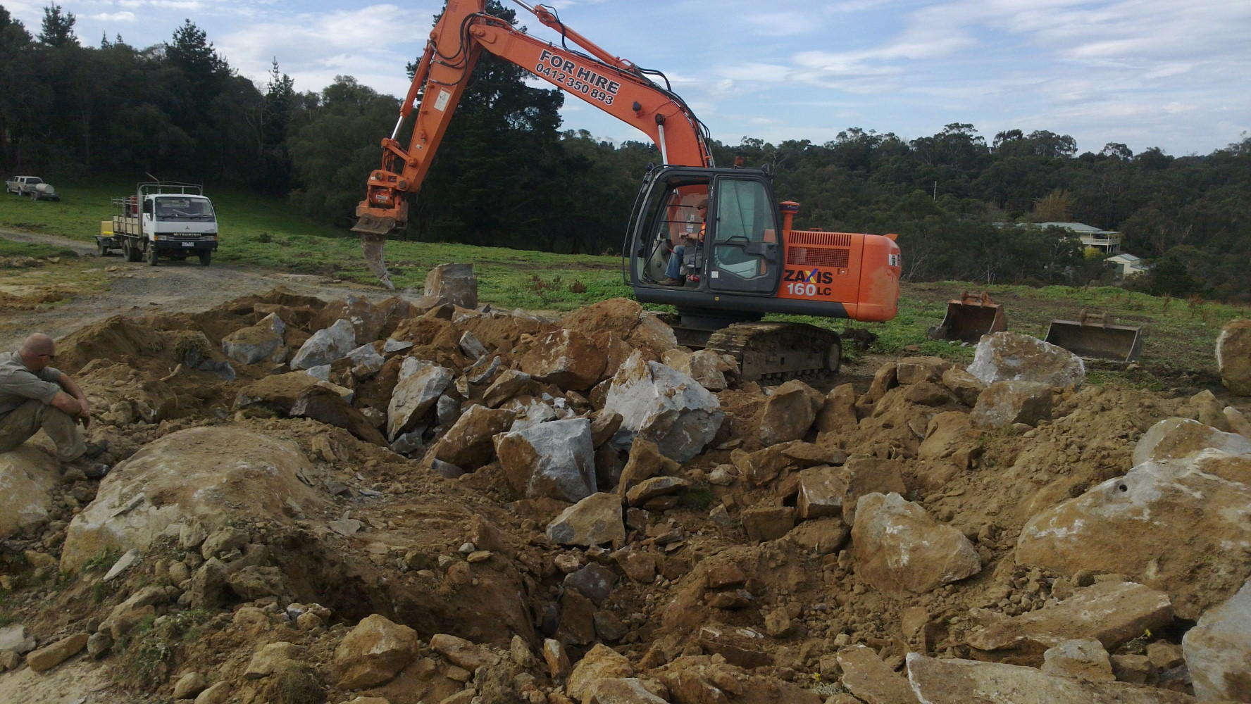 A site development project requiring extensive excavation, rock breaking, blasting and material removal