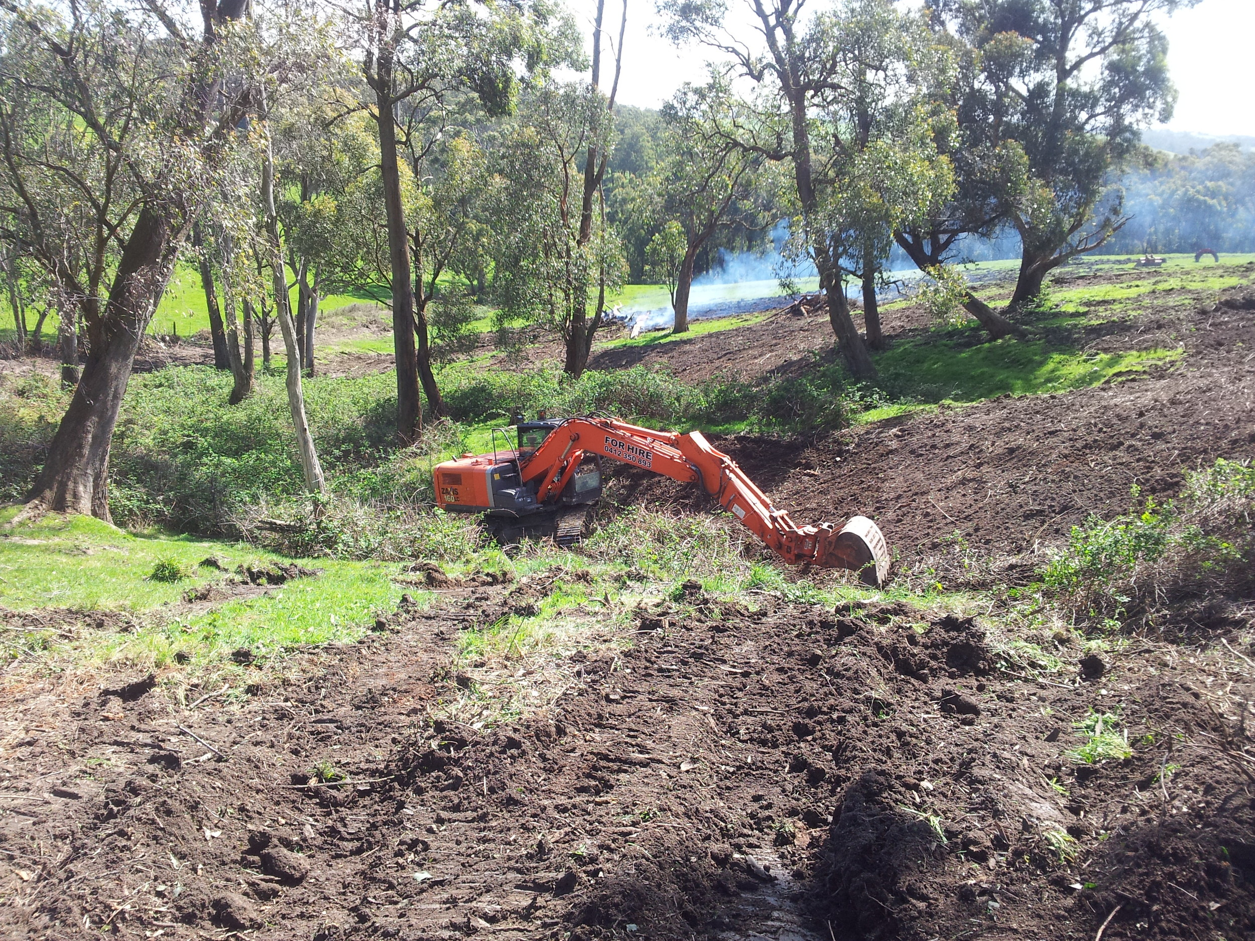 Removal of blackberries, tree stumps and erosion protection.