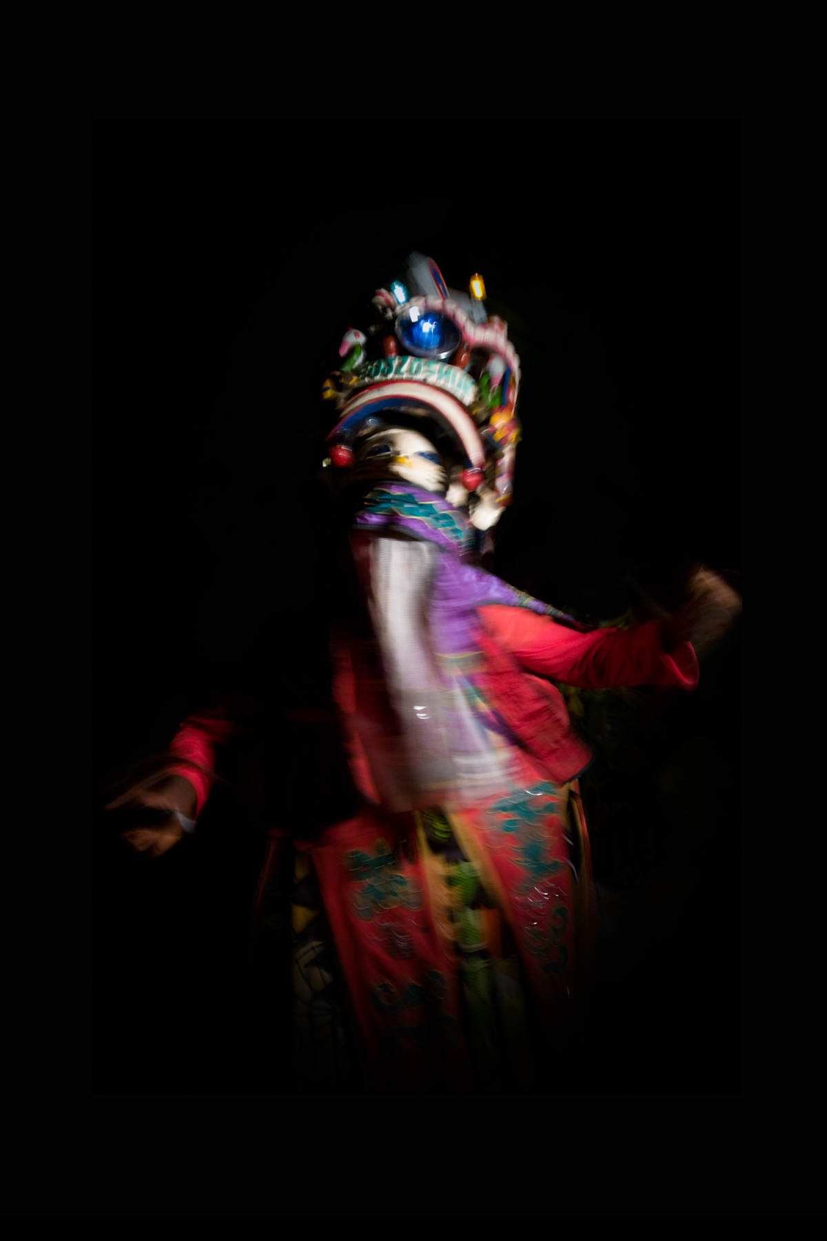 A gelede dancer at an all night ceremony held as part of the extended funeral rites for a local dignitary, Illara.
