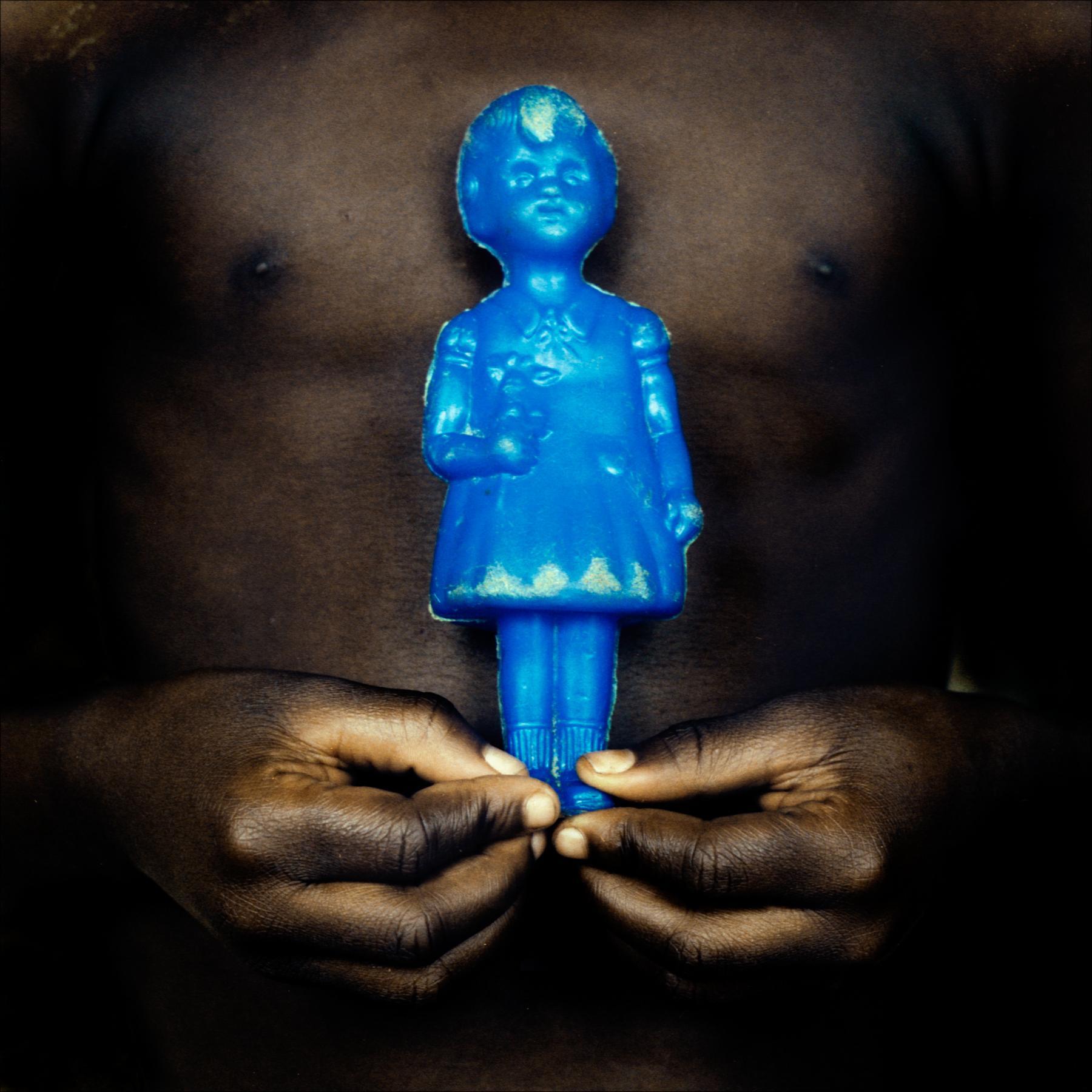 Toys: plastic doll, Ketou.