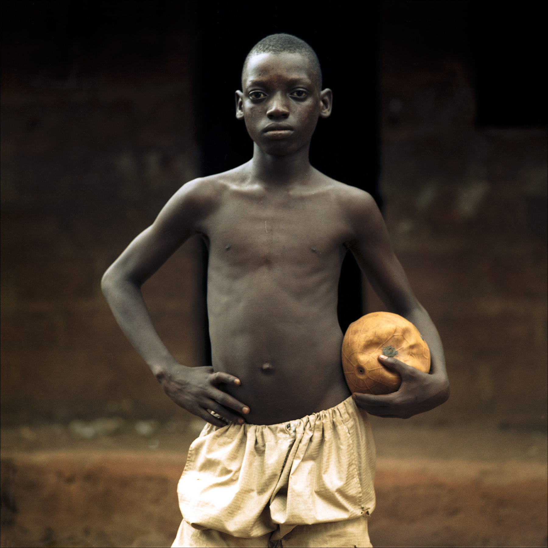 The captain of a local football team with his ball, Ketou.