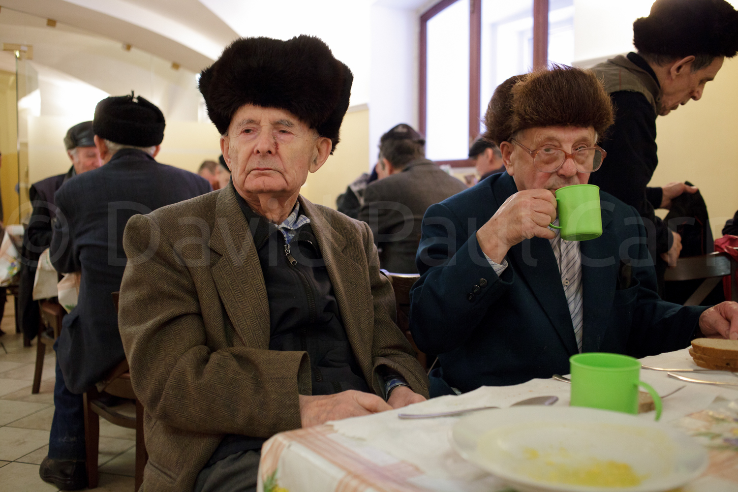 Elderly men at lunch in the free canteen of the Saint Petersburg synagogue.